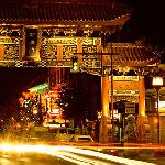 Chinatown gate with trail of lights at night