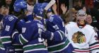 Roaring start allows Canucks to cruise to 7-3 win over Chicago