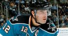 Sharks hold off Red Wings in opener