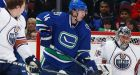 Oilers hold off Canucks