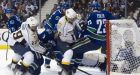 Predators grind out 2OT win over Canucks