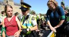 Pipeline protesters cross barricades on Parliament Hill