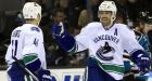 Schneider wins 4th-straight as Canucks down Sharks