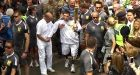 Olympic torch relay: Injured soldier walks with flame