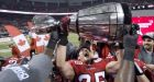 Grey Cup broken by celebrating Stampeders