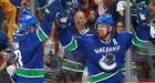 Canucks hold off Flames to avoid elimination
